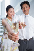 Happy couple dressed up for a date having champagne — Stockfoto