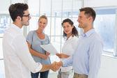 Businessmen shaking hands — Stock Photo