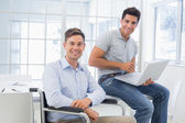 Businessman working with colleague — Stock Photo