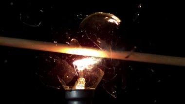 Arrow shooting through light bulb — Stock Video