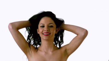 Beautiful brunette shaking her hair — Stock Video