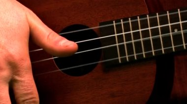 Hand strumming guitar strings — Stock Video