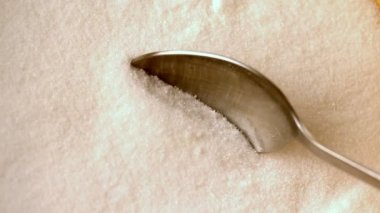 Teaspoon scooping up white sugar — Stock Video