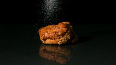 Sugar sprinkling on scone — Stock Video