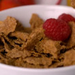 Berries pouring into cereal bowl — Stock Video #45181145