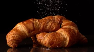 Powdered sugar sprinkling onto croissants — Stock Video