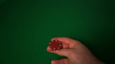 Hand flipping red casino chip — Stock Video