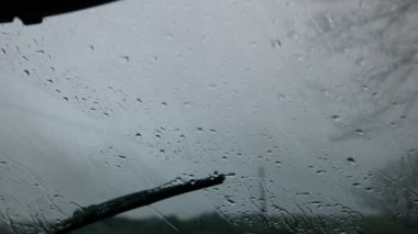Windscreen wiper wiping rain away — Stock Video