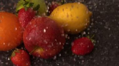 Water raining on selection of fruit — Stock Video