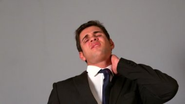 Businessman rubbing his sore neck — Stock Video