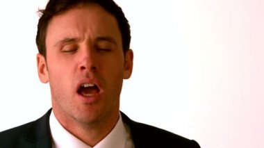 Businessman sneezing — Video Stock
