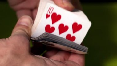 Hand flicking through deck of cards — Stock Video