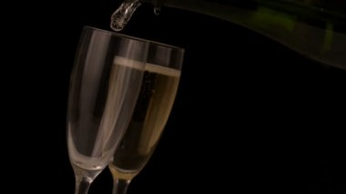 Champagne pouring into flutes — Stock Video