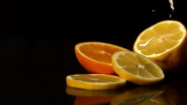 Whipped cream pouring onto orange slices — Stock Video