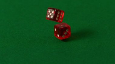 Red dice falling on casino table — Stock Video
