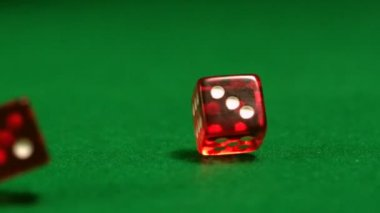 Red dice rolling on casino table — Stock Video
