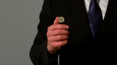 Businessman flipping a euro coin — Stock Video