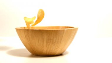 Chips falling in wooden bowl — Stock Video