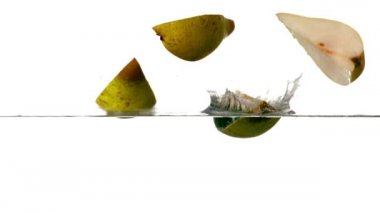 Pear segments plunging into water — Stock Video