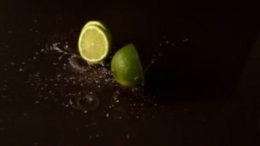 Lime pieces dropping on wet surface — Stock Video