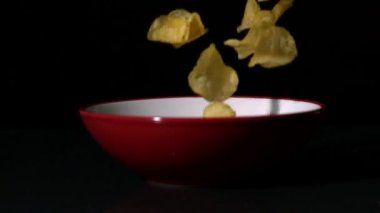Chips falling into bowl — Stock Video