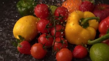 Water raining on fruit and vegetables — Stock Video