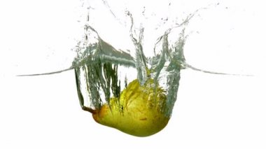 Pear plunging into water — Stock Video