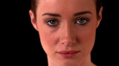 Beautiful brunette looking at camera — Stock Video