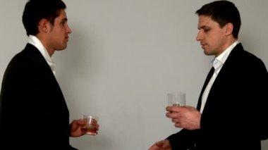 Men drinking whiskey shaking hands — Stock Video