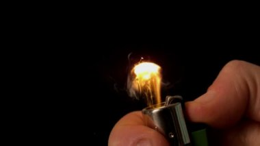 Hand lighting a lighter — Stock Video