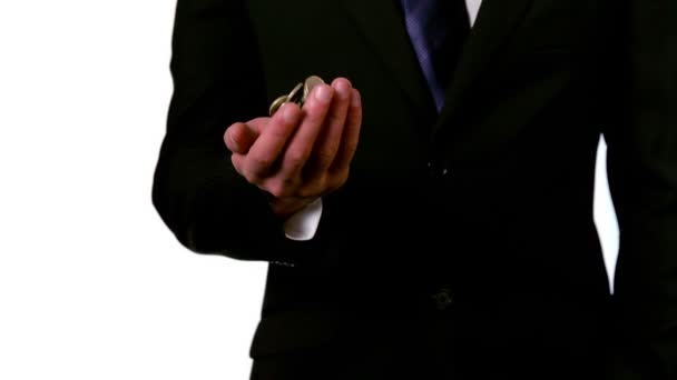 Businessman throwing and catching coins — Vidéo