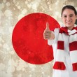 Football fan in white wearing scarf showing thumbs up — Stock Photo #46743359