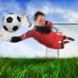 Goal keeper jumping up and saving ball — Stock Photo #46743511