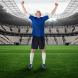 Composite image of football player celebrating a win — Stock Photo