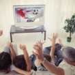 Family cheering and watching the world cup at home — Stock Photo