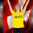 Excited football fan in brasil tshirt — Stock Photo