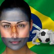 Composite image of argentina football fan in face paint — Stock Photo