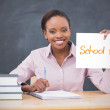 Happy teacher holding page showing school trip — Stock Photo #46745823