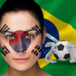 Composite image of korea football fan in face paint — Stock Photo
