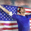 American soccer fan holding flag — Stock Photo