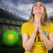 Nervous football fan in brasil tshirt — Stock Photo