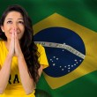 Nervous football fan in brasil tshirt — Stock Photo #46747803