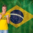 Excited football fan in brasil tshirt — Stock Photo #46748305