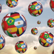 Composite image of footballs in international flags — Stock Photo #46749011