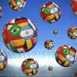 Composite image of footballs in international flags — Stock Photo #46749417
