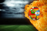 Composite image of fire surrounding international flag football — Stock Photo