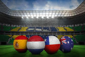 Composite image of footballs in group b colours for world cup — Stock Photo