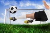 Football player kicking the ball — Stock Photo