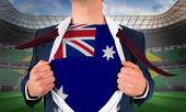 Businessman opening shirt to reveal australia flag — Stock Photo