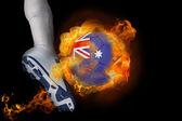 Football player kicking flaming australia ball — Stock Photo